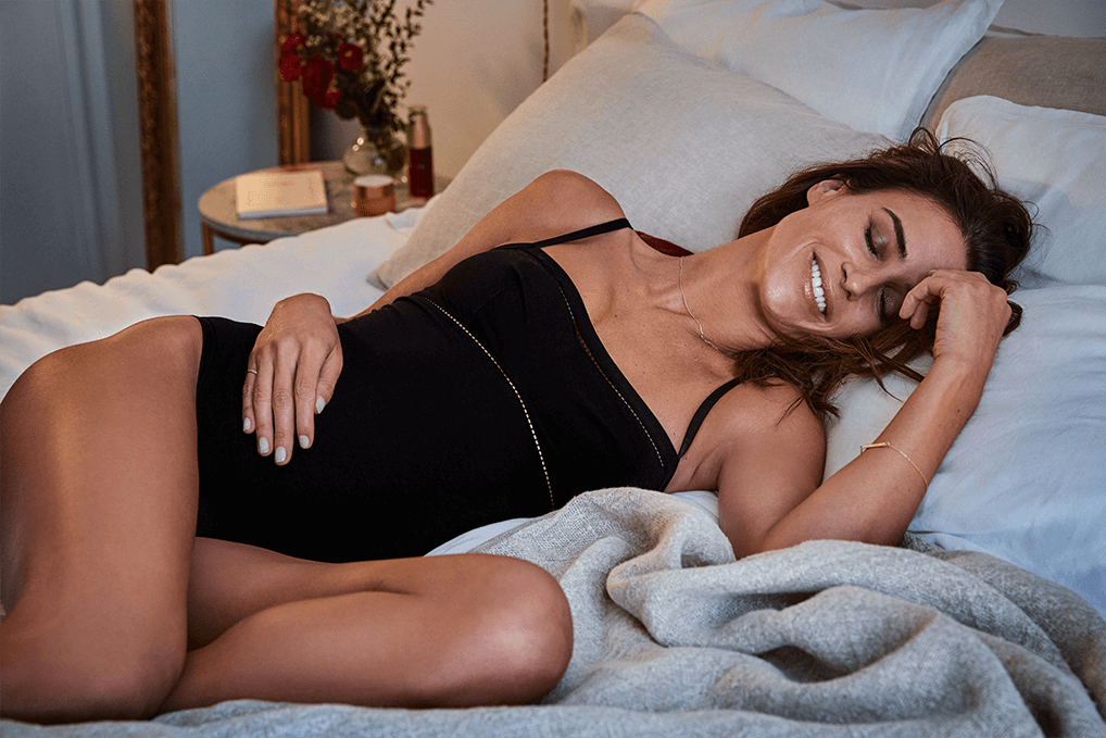 Model on bed visual